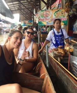 Buying food at the floating market